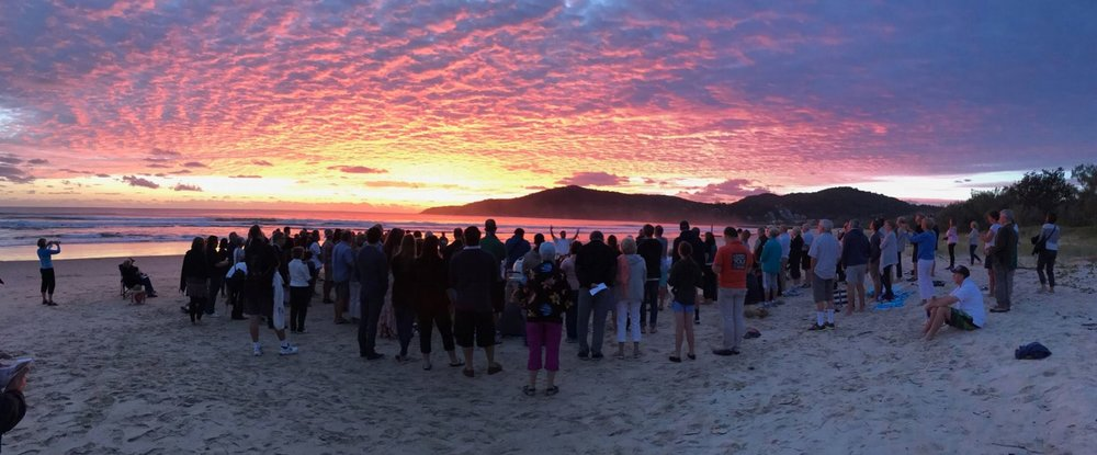Worship on the beach –  Easter sunrise at Noosa, Queensland, Australia.