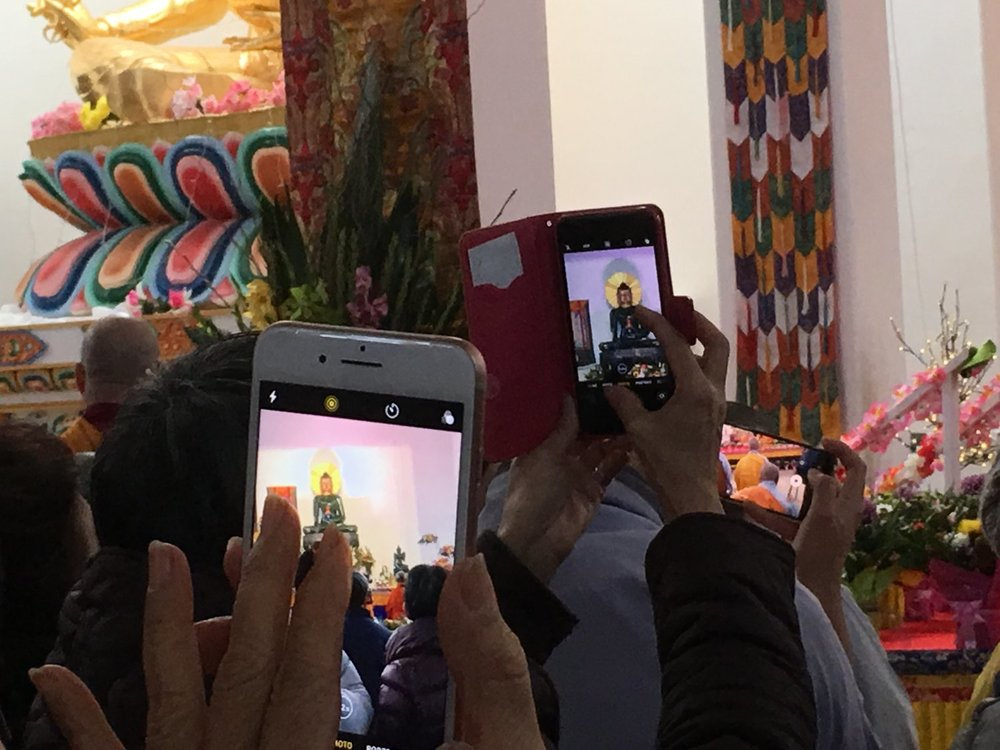 """Catherine's photo of photographers of the Jade Buddha. Track back through the ALL-Archive to find her post """"Welcoming the Jade Buddha."""""""