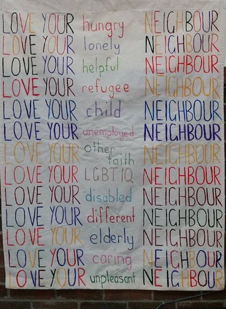"""""""Love your neighbour"""" wall hanging."""