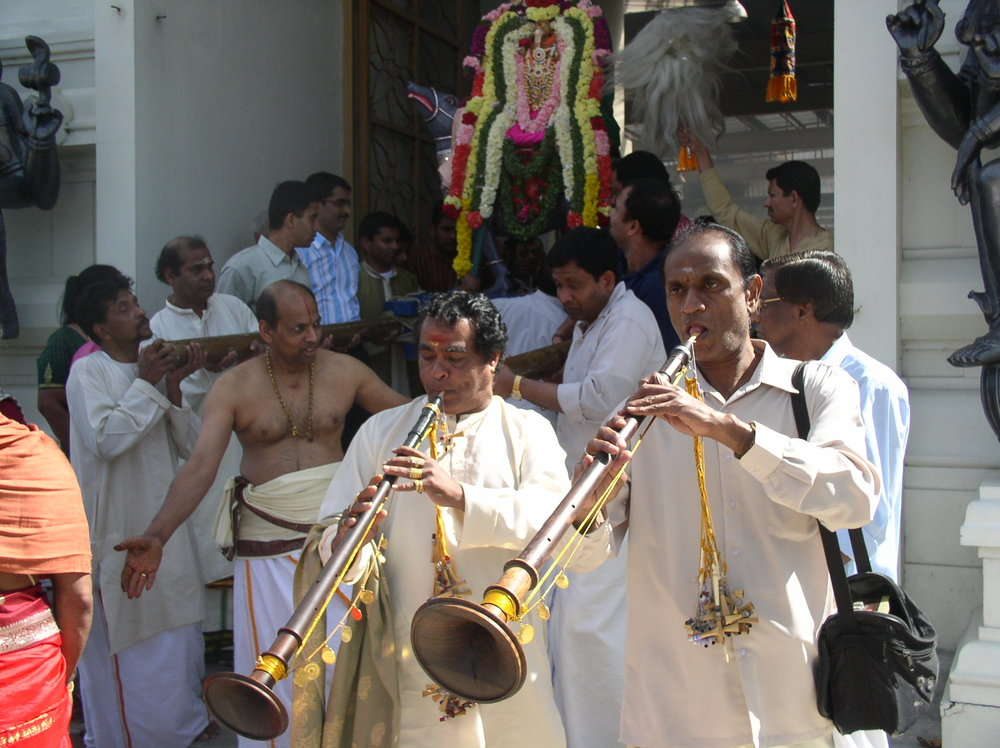 Emerging from the Temple with Ganesha statue on a bier, full accompaniment of Nagaswarams and drums