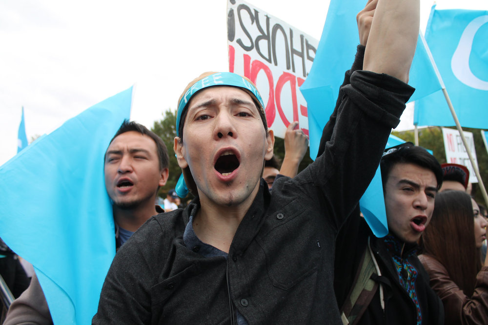 A man demonstrating for Uyghur human rights at the White House in Washington DC. Photo:  Elvert Barnes.