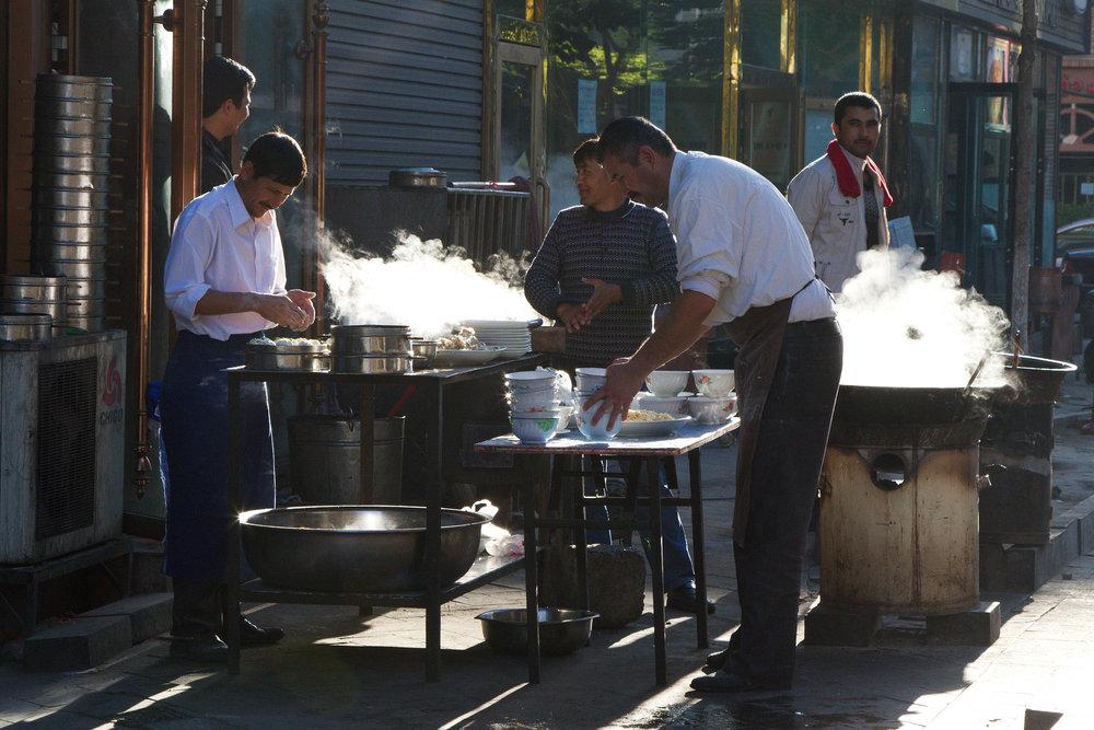 Restaurant staff in Urumqi prepare for morning customers. Photo:  Martha de Jong-Lantink .