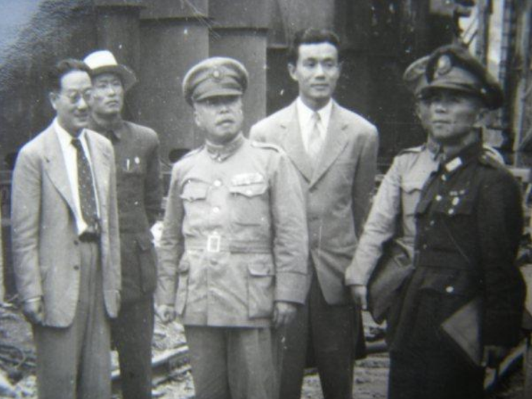 Stalling for time, Taiwan province chief executive Chen Yi (centre) grudgingly accepted the 228 Incident Settlement Committee. Photo courtesy of  Wikimedia Commons .
