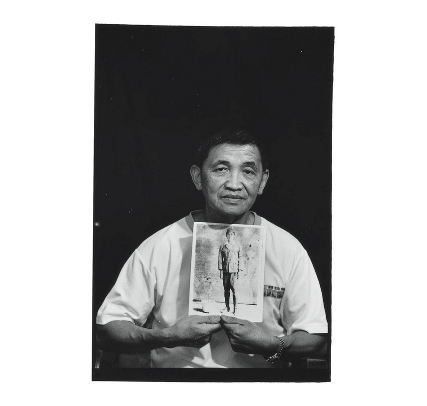 Wang Jie-po holds a photo of his father Wang Kui-liang in his youth. Photo courtesy of Pan Hsiao-hsia, from the book  Testimonies of 228  (見證228).