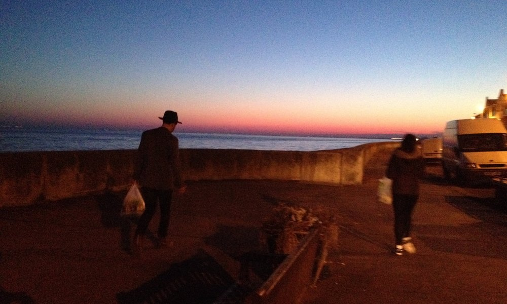Folkestone residency for  The Apple Cart ; Al and Zoë on the way home from the shops.