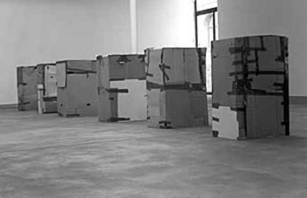 Workers Who Cannot Be Paid, Remunerated to Remain Inside Cardboard Boxes  by Santiago Sierra