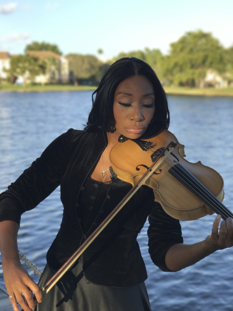 Kizie N. Washington - Manager/ Violist/ Violin