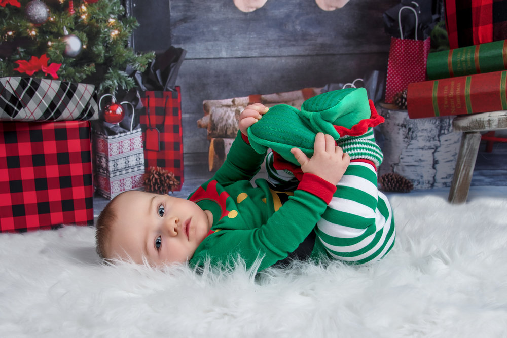 6th month old baby boy dressed as elf holiday Christmas mini session portrait