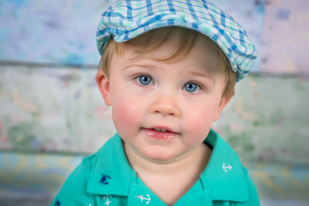Baby boy with blue eyes and newsie hat easter portraits