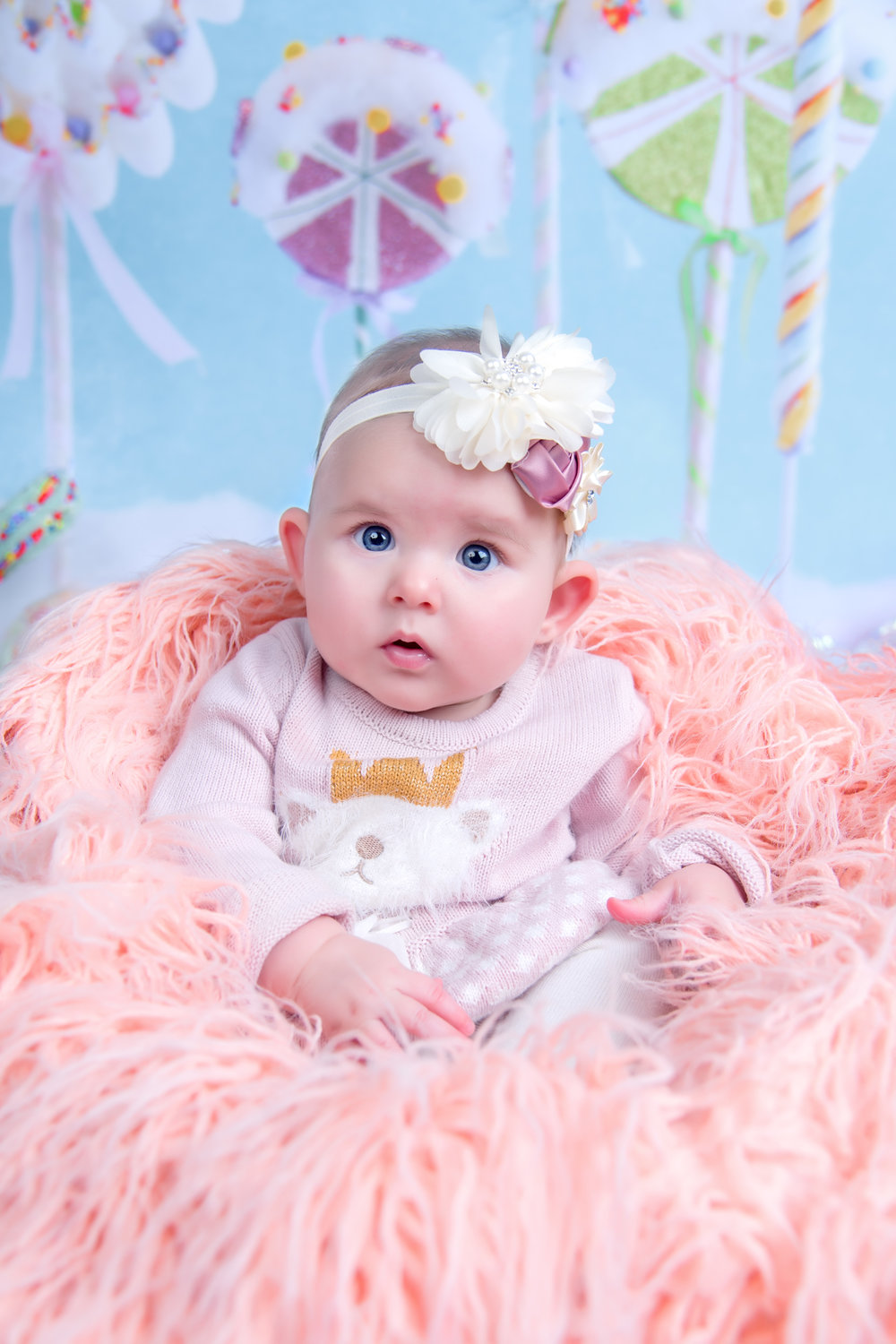 Baby girl in pink at Candy Land holiday Christmas portrait session