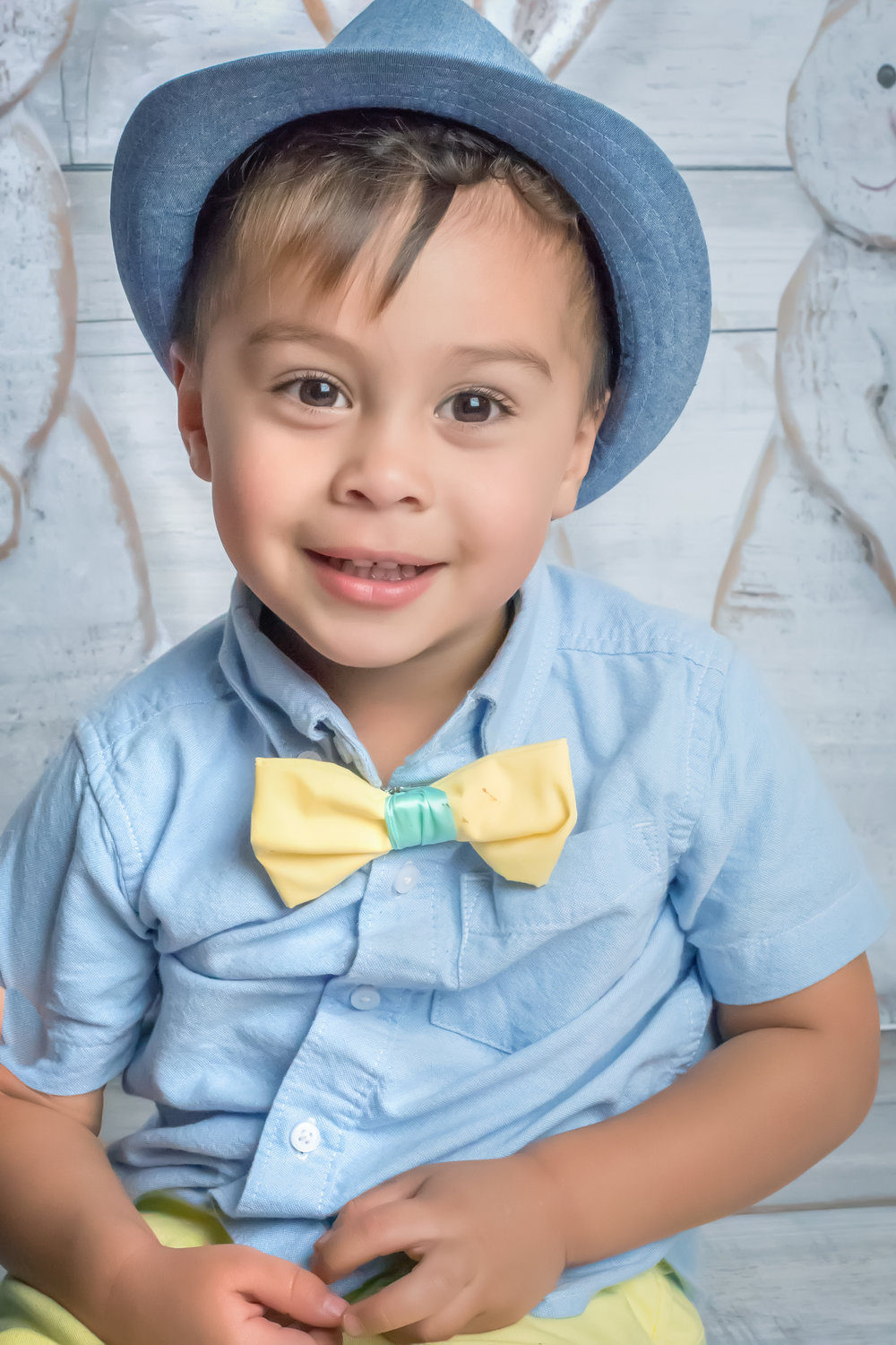 Little boy in blue and yellow bow tie Easter Portrait