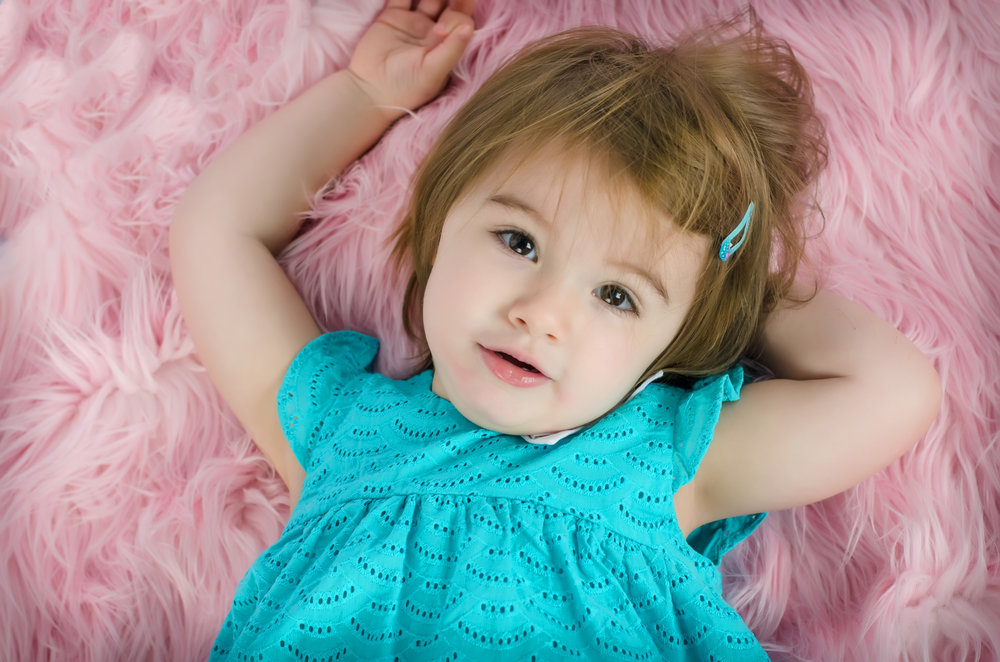 Little girl in teal and pink