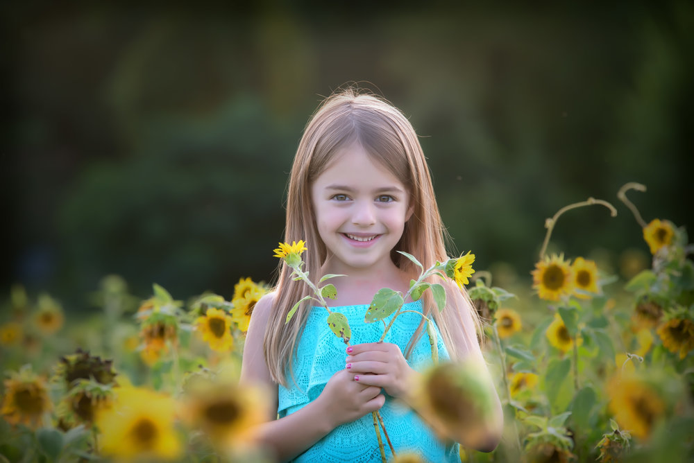 Little girl in sunflower field in Chesterfield Virginia