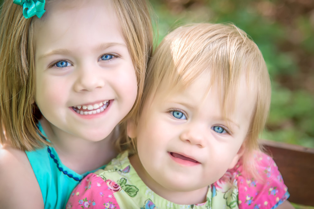 Sisters with blue eyes in Spring portraits at Bryan Park in Richmond Virignia