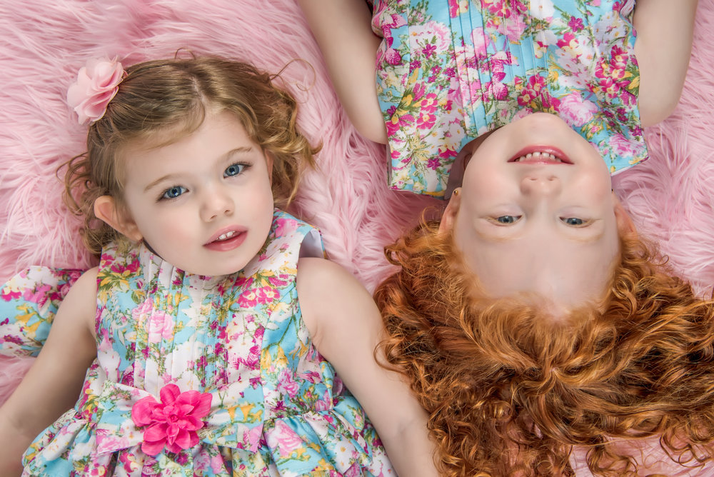 Sisters at Easter Session in floral dresses and pink and blue