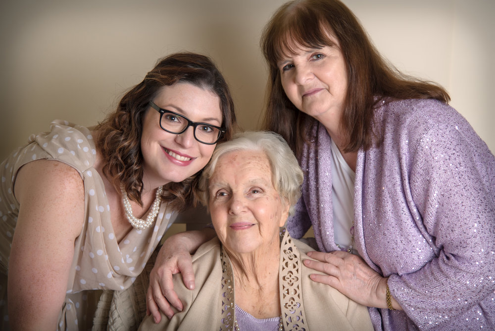 three generation of women family portrait in tan and lilac purple