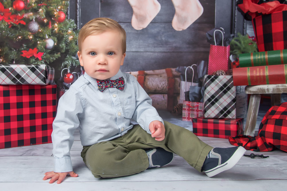 Holiday Christmas mini session with little boy in bow tie and plaid