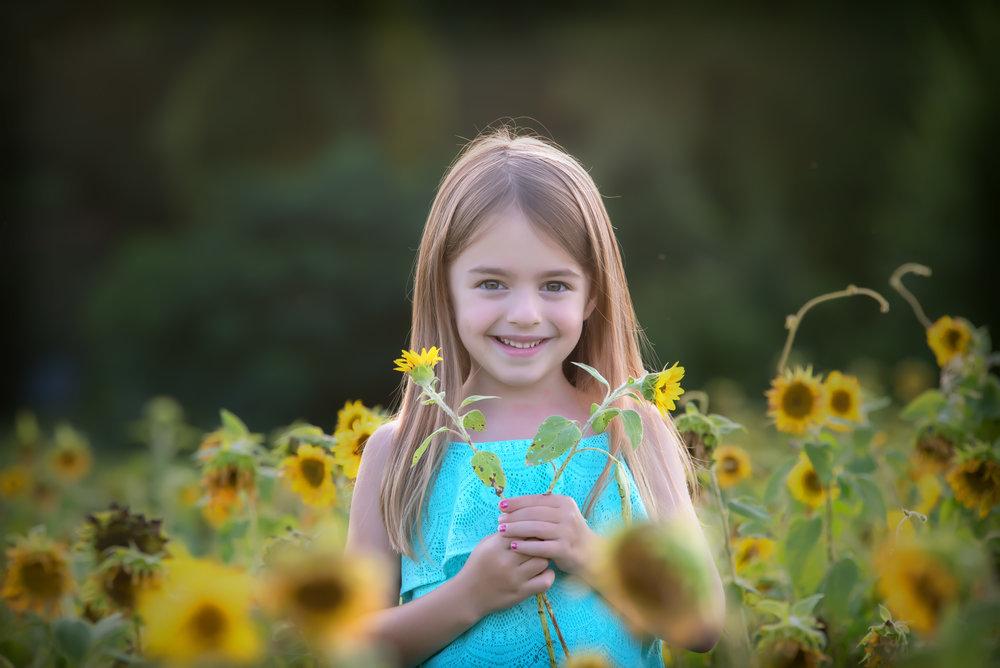 Little girl in sunflower field mini session