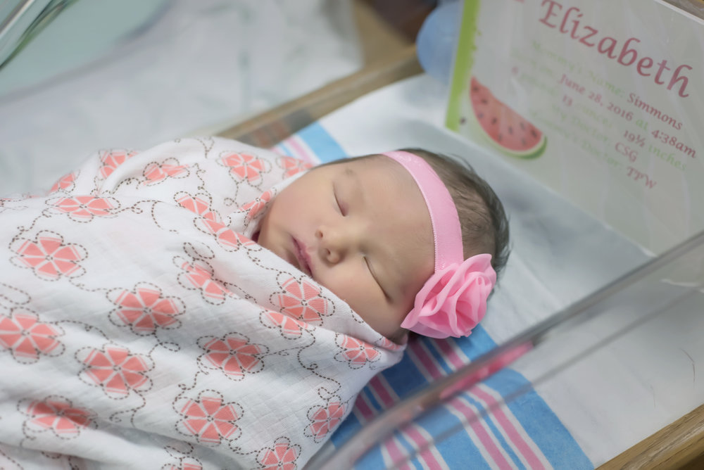 Newborn baby girl in pink at fresh 48 hospital session