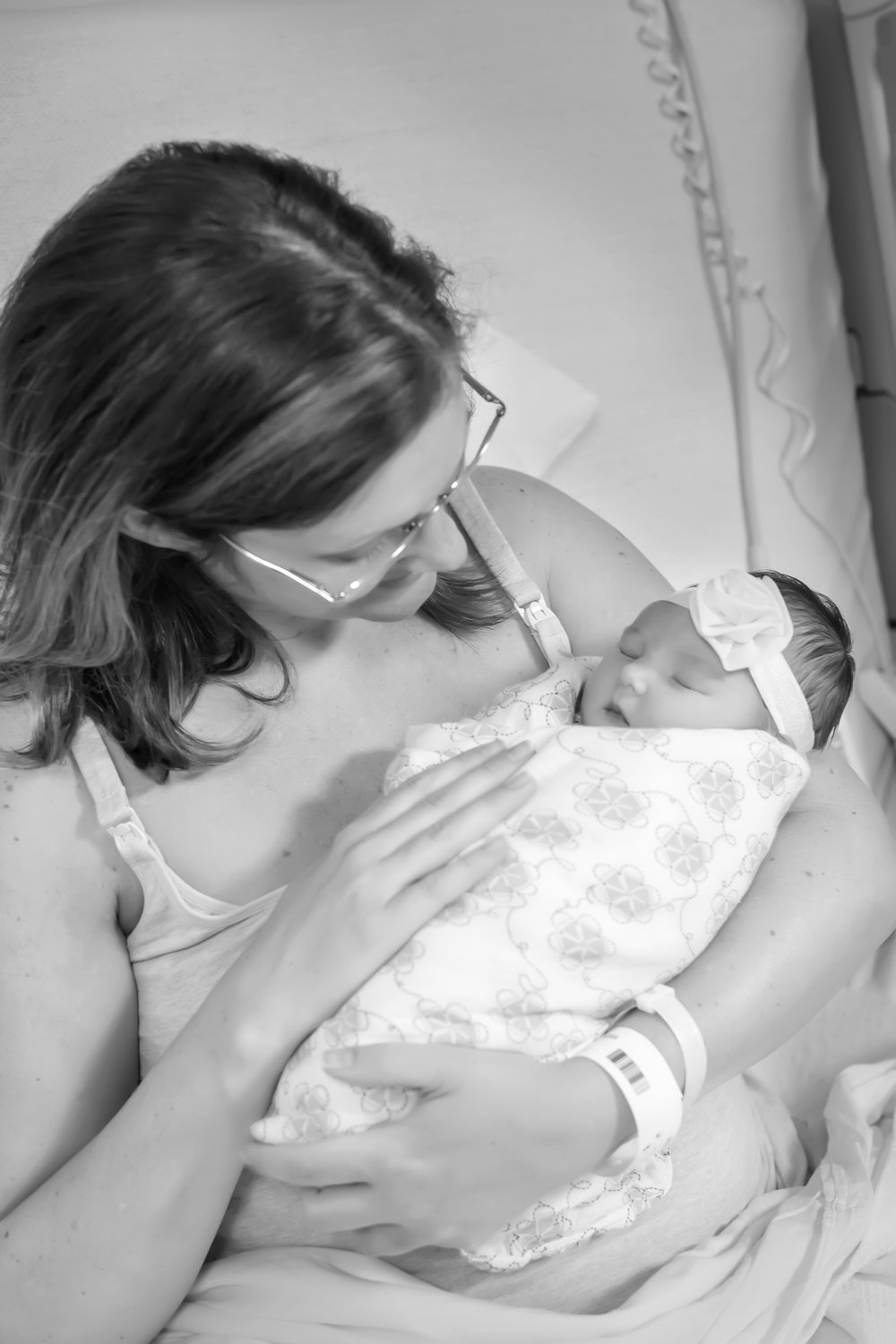 Mother and newborn baby girl at Fresh 48 Photography Session