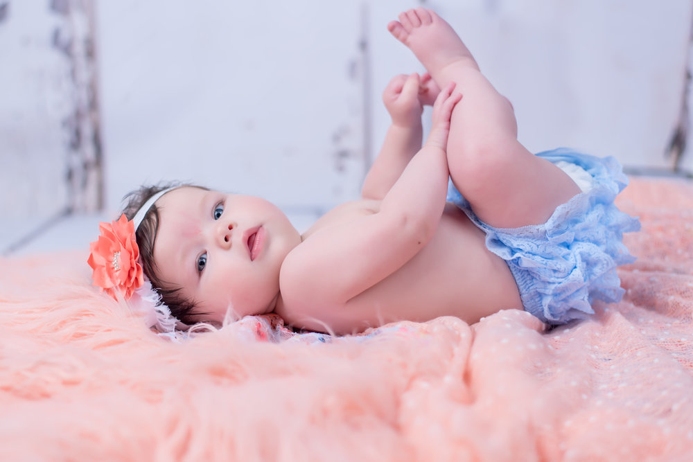 4 month old baby girl in blue and peach