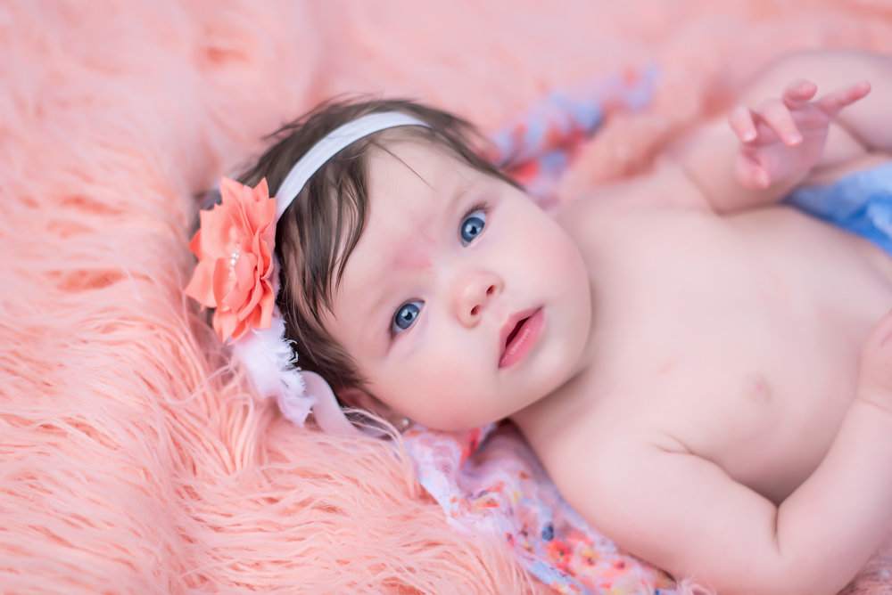 4 month old baby girl in floral peach and light blue, periwinkle