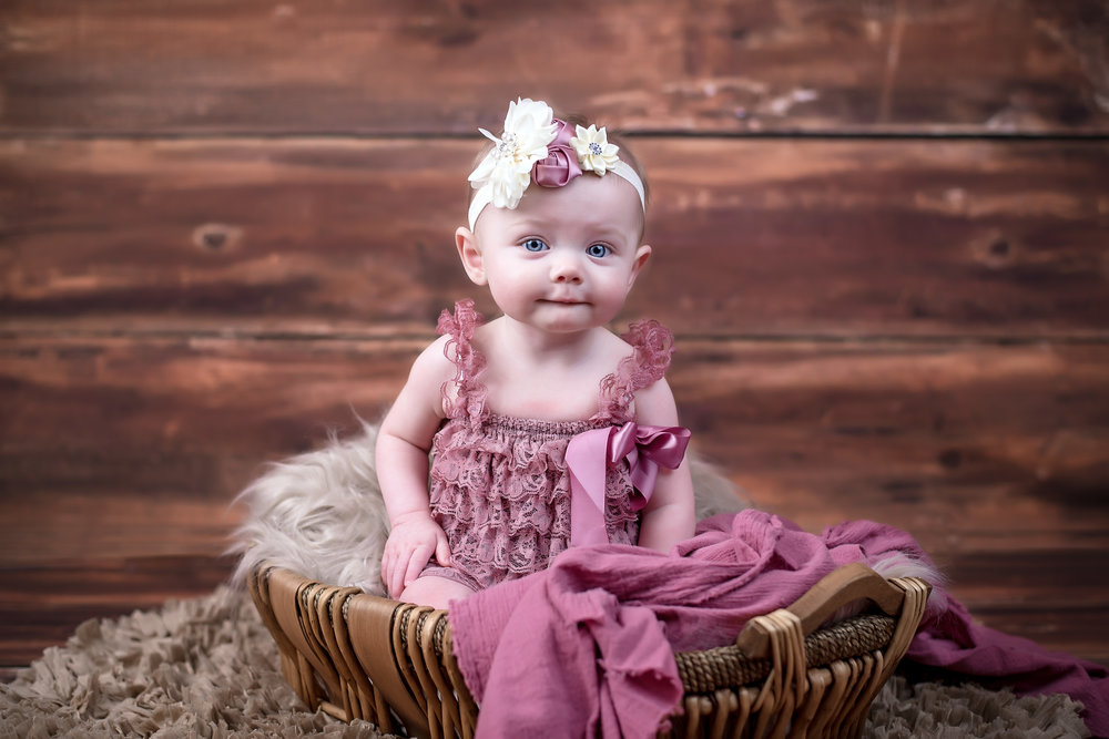 6 month old little girl in rose and tan