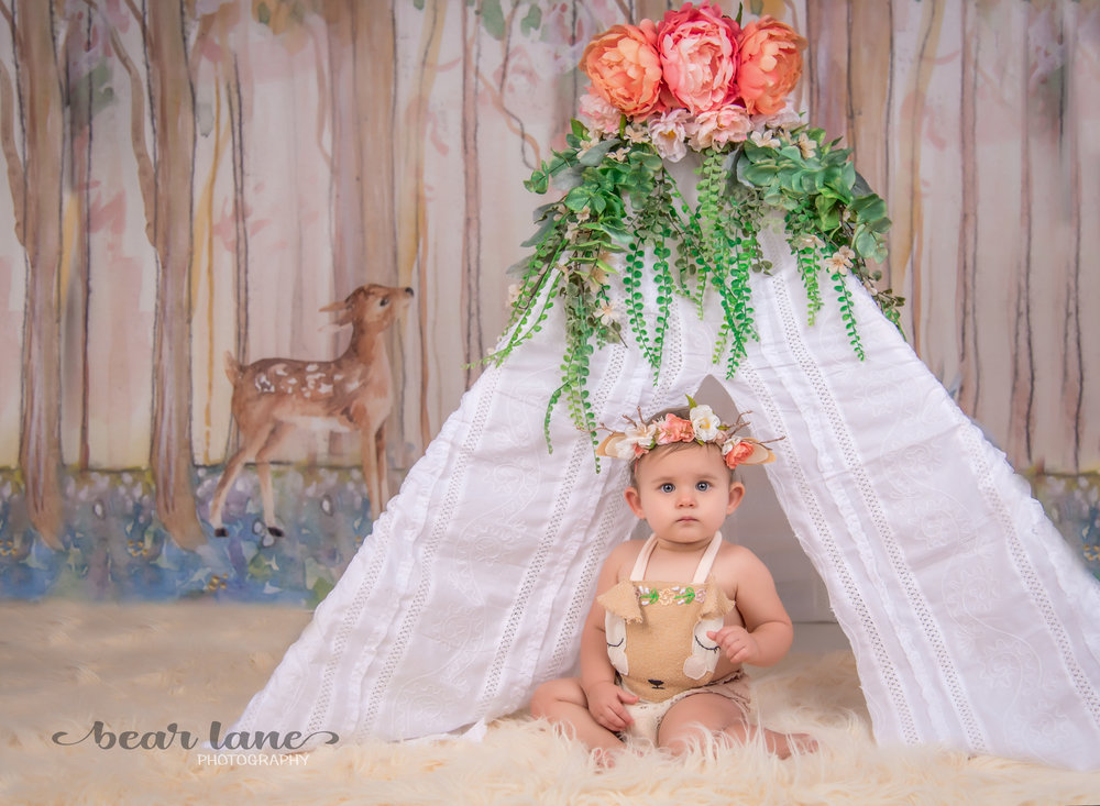 Little girl as baby deer fawn with tent, woodland themed 1st birthday portrait session