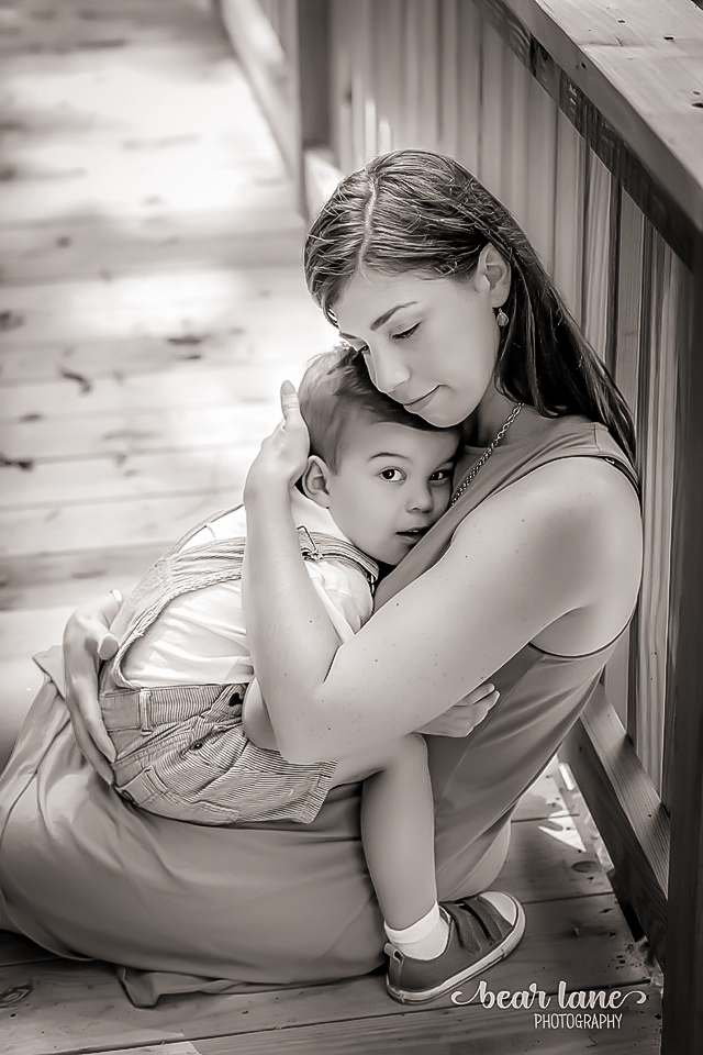 MOther and son embracing on Bridge in Summerlake Neighborhood in Moseley Virginia