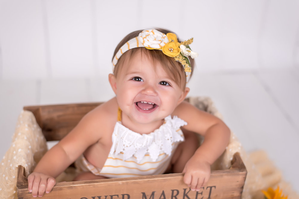 1 year Old girl in yellow flower and flower market box portrait