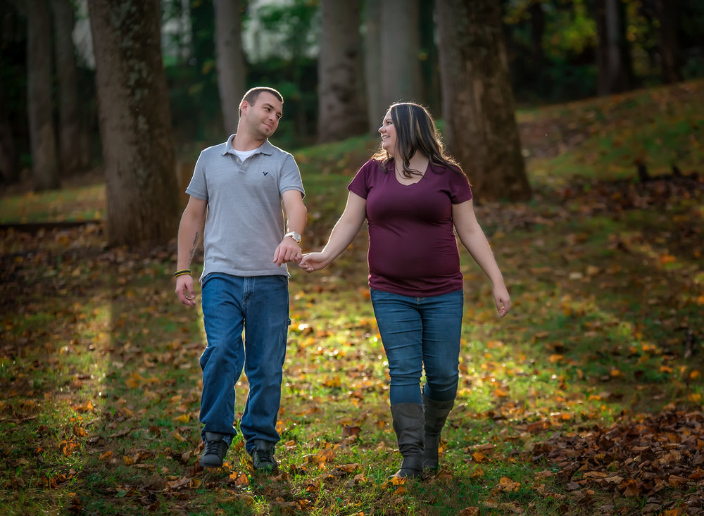 Couple walking in fall portraits