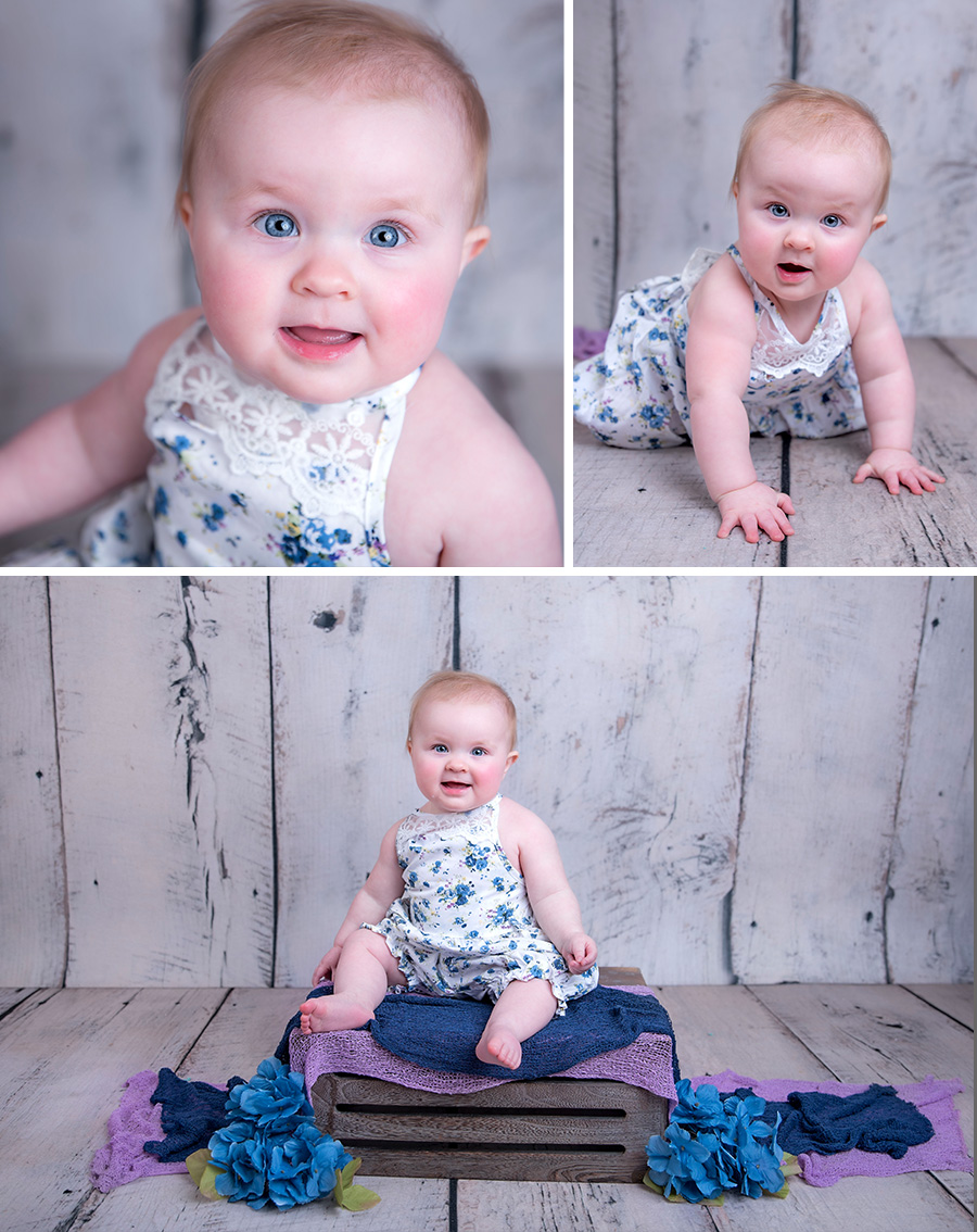 baby girl in blue and purple flowers first birthday portrait.jpg