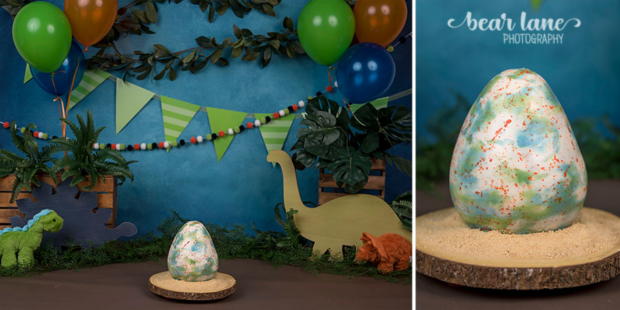 Dinosaur baby boy cake smash with dino egg cake blue orange and green