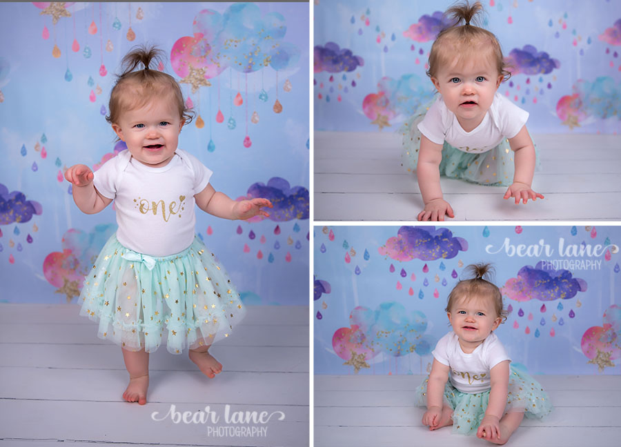 baby girl rainbow rain cloud unicorn first birthday portraits