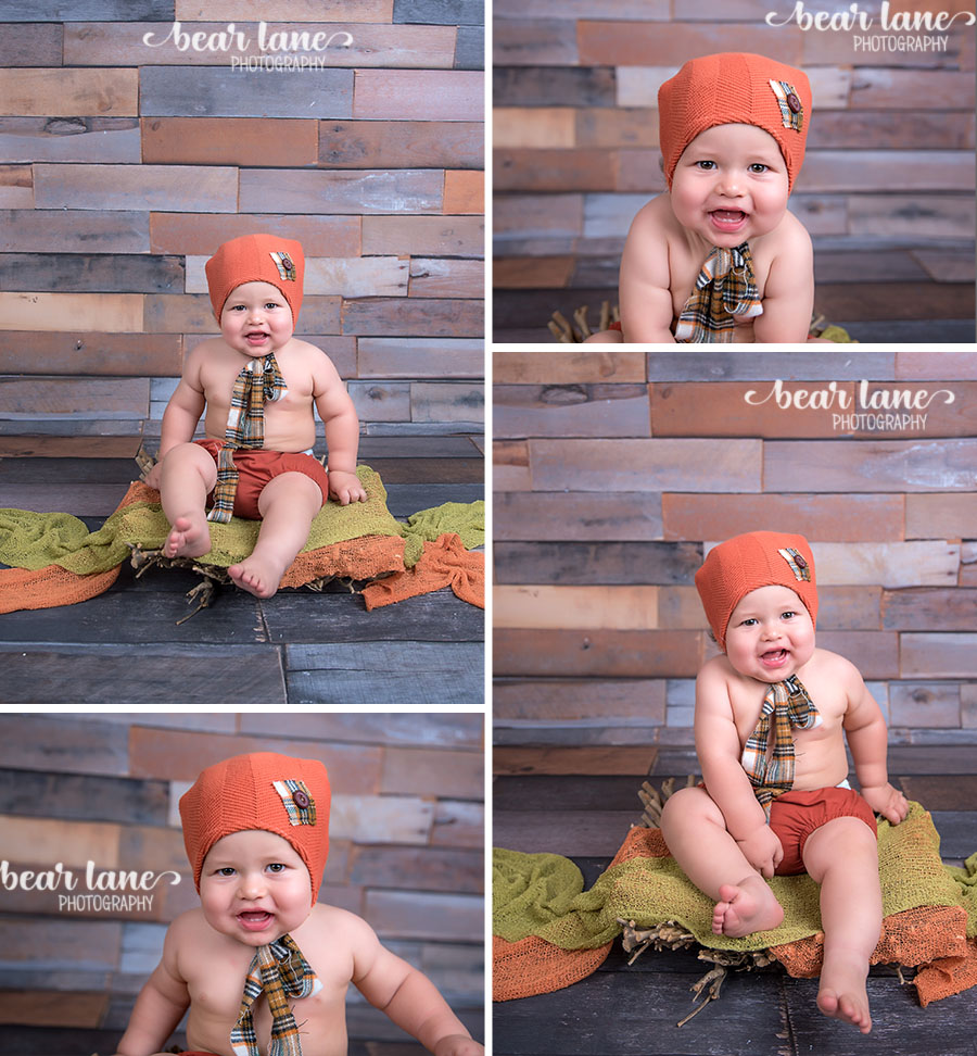 baby boy first birthday portrait fall pumpkin orange hand plaid