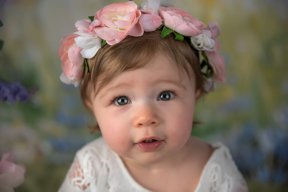 1 year old girl boho floral crown on floral swing spring