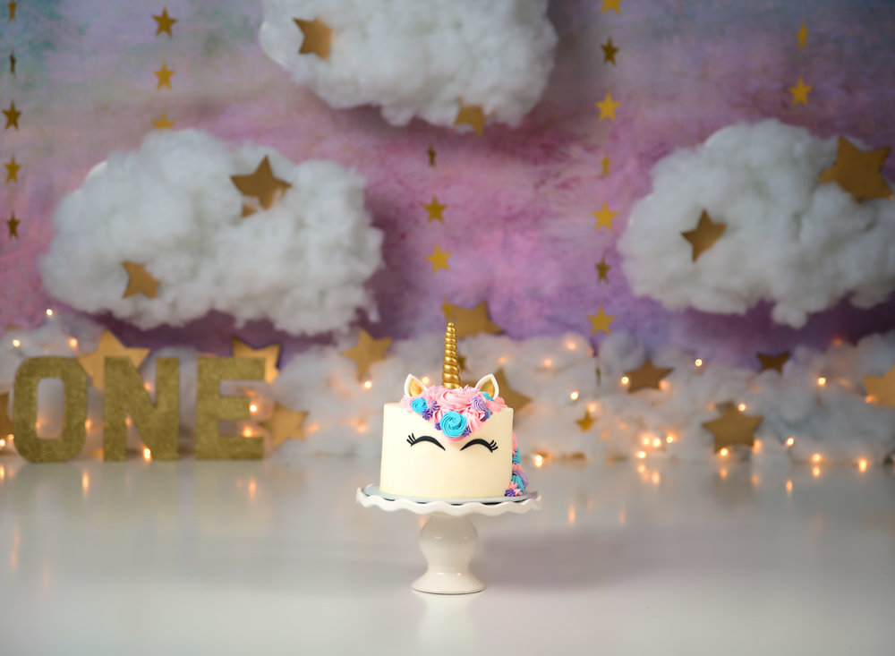 Unicorn cake smash with rainbow cloud and gold stars