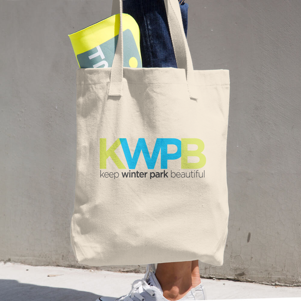 A KWPB branded tote bag.