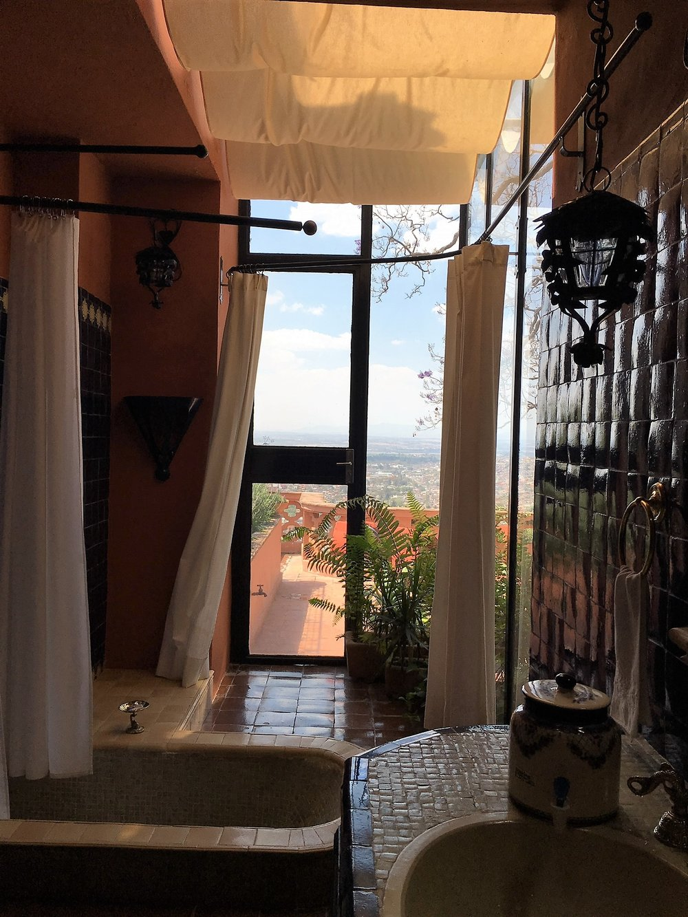 Can you believe this fabulous bathroom in our San Miguel de Allende apartment? Sunken tub with a view!
