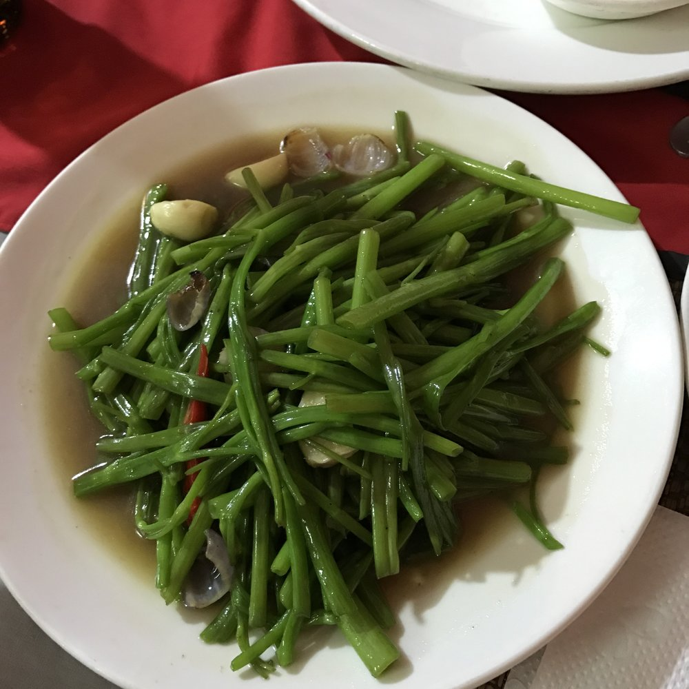 Stir fried morning glories in oyster sauce! I remember Daddy battling morning glories that grew in his cotton and soy bean fields. Who knew we could have eaten them! They are delicious! But, actually, anything is oyster sauce is delicious!