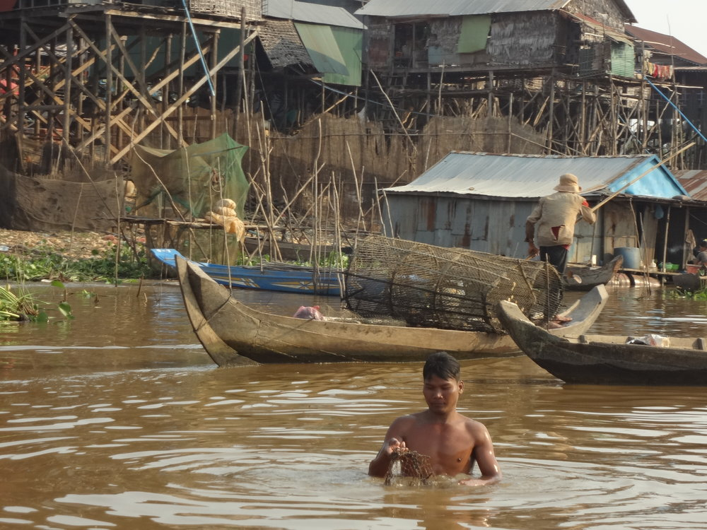 This young man appeared to be having a problem with his fishing net and was working on it. I asked Chamnan if there are snakes in the water. He said there are, but nobody worries about them. They just catch them for supper!