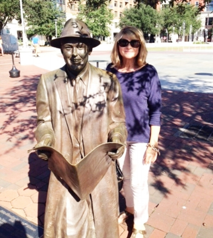 In Savannah with Johnny Mercer in Ellis Square. Do you know how he is connected with Midnight in the Garden of Good and Evil?