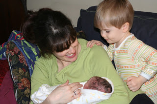 Mom, newborn, and brother, moments after homebirth in Queens (BirthMattersNYC blog)