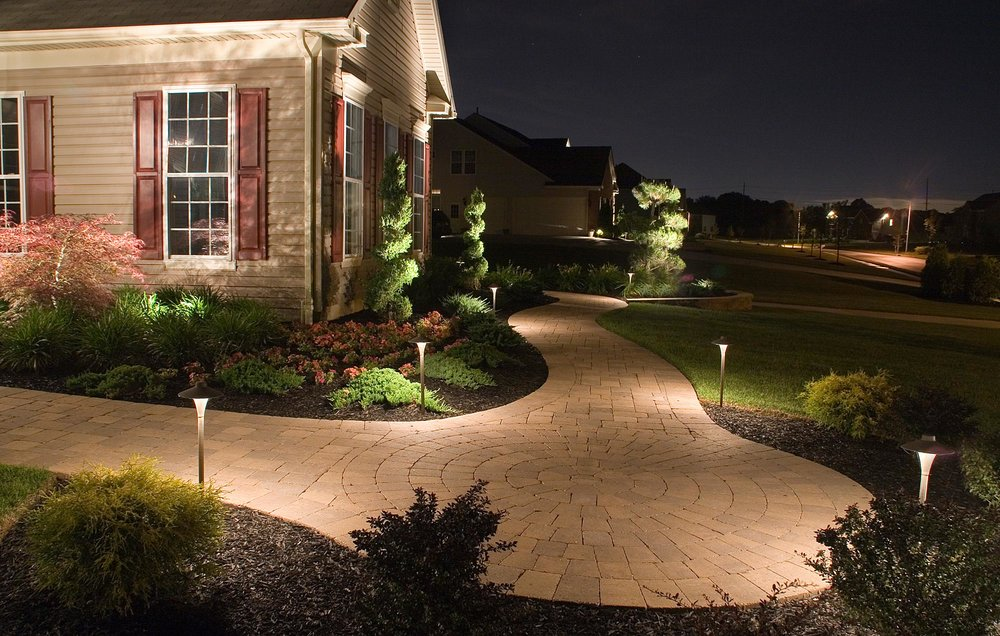 Path-lighting is created by placing small fixtures along the borders of walkways, driveways, and patios. It is important that the style of these path lights be considered carefully. It is also important to be sure that they are positioned to illuminate the path, but also placed so that they avoid being kicked, moved, or getting in the way of the lawnmower.