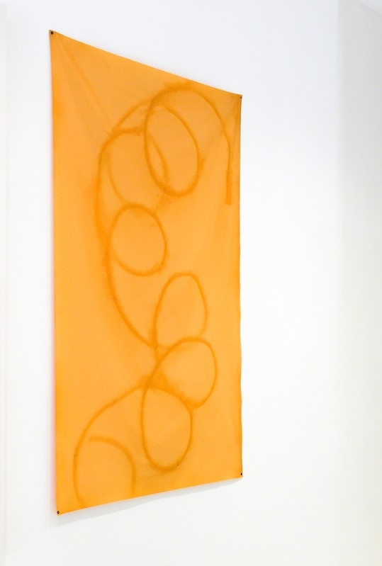 Sam Falls,  Untitled (Orange 1, Topanga, CA) , 2012, dyed cotton and polyester with metal grommets.