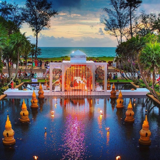 At a wedding in Phuket, this custom mandap was covered with hundreds of tiny mirrors to reflect the sparkle of the sun and water.
