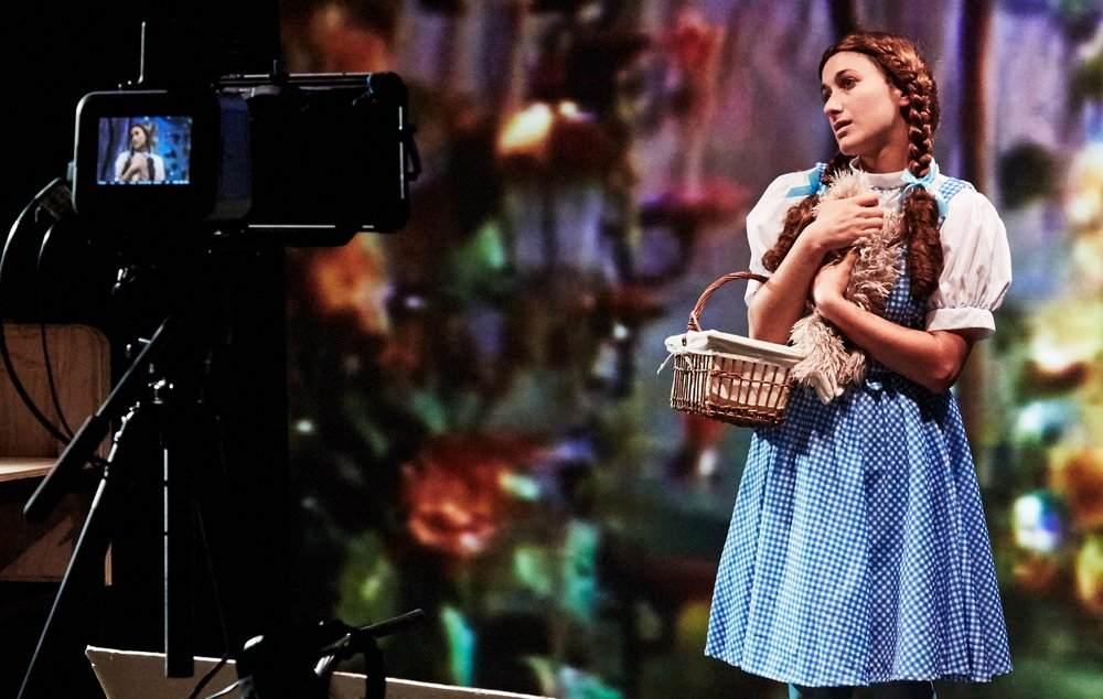 Hannah Heller takes her turn as Dorothy in Elements of Oz. Top: A stage view of the production. Photos by Gennadi Novash.