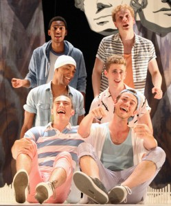 Six cast members singing