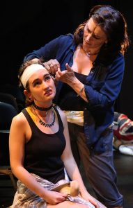 "Diane dresses Julia's head wound in ""The Birds."" Photos by Carol Rosegg."
