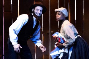 Sheppard (left) as an abolitionist who aids a runaway slave (Kidwell). Photos by Ben Arons.